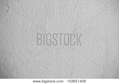 The grey grungy wall. White wall texture background. The plaster on the wall. Uneven wall surface. The paint on the wall. Plastered walls. Abstract background. Painted brick wall. Drops of paint on the wall