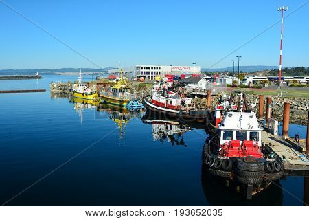 Victoria BC,Canada,August 3rd 2014.Tugboats docked at Ogden Point in Victoria BC.on a beautiful summer day.