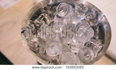 Bar Cooler With Ice. Cooling Of Alcohol And Cocktails With Ice. Ice Cubes Close-up