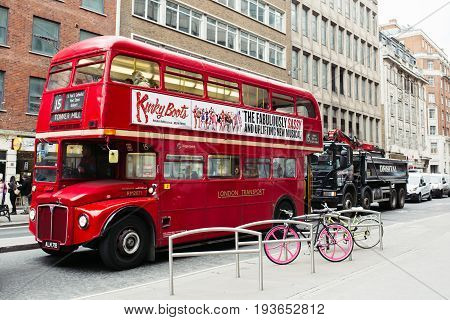 United Kingdom, London - 24 December, 2016: Classic Retro Red Routemaster Double Decker Bus on the busy street in central London, Great Britain. One of the most iconic symbol of London.
