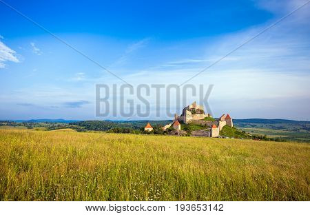 Rupea Romania - June 23 2013: Tourists visiting the old medieval fortress on top of the hill Rupea village located in Transylvania Romania