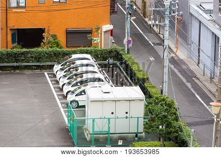 Electric car or Electric Vehicle (EV) parking lot with charging station in Tokyo Japan