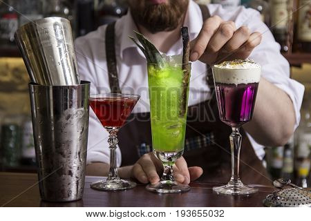 close up bartender making alcohol coctail in restaurant
