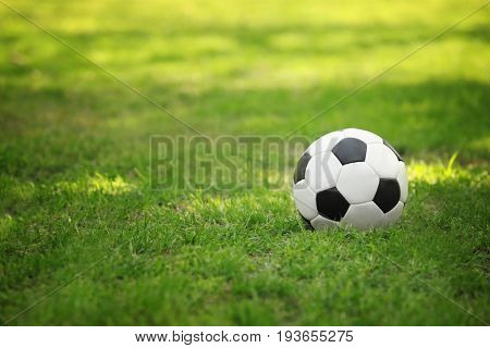 Soccer ball on green grass in park