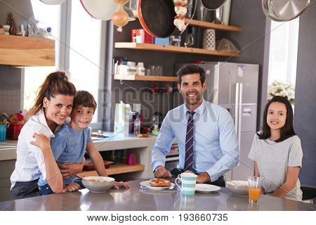Father Having Family Breakfast In Kitchen Before Leaving For Work