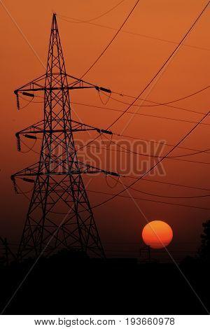 high voltage post.High voltage tower with sunrise