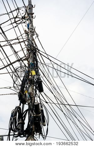 A post with a lot of wires