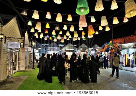 DOHA, QATAR - APRIL 8, 2017: Qatari women and other visitors in the