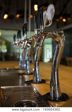 Beer taps in row at restaurant counter