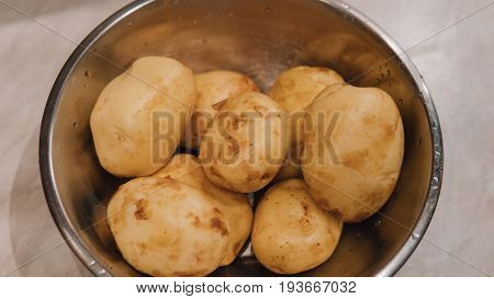 Clean Young Potatoes In A Metal Bowl Close-up.healthy Way Of Life And Starch In Potatoes