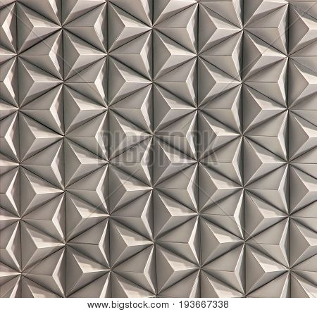 Pattern of white pyramid shapes. Wall of pyramid tiles. Abstract background.
