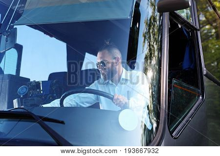 Bus driver. A handsome bus driver in the bus