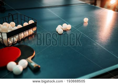 Ping pong table, rackets and basket with balls