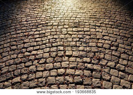 Gloomy old cobblestone pavement. Beautiful natural background