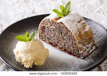 Homemade Poppy Strudel With Powdered Sugar And Vanilla Ice Cream Close-up. Horizontal
