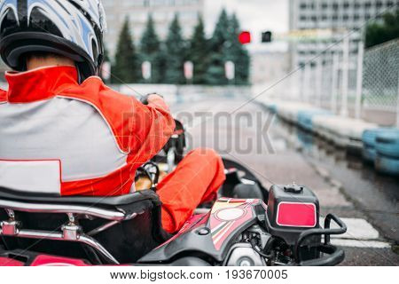 Karting racer, go kart driver in helmet, back view