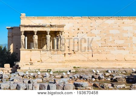 Acropolis of athens, porch of caryatids, Erechtheum Temple in Greece and blue sky