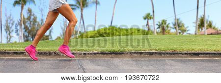 Athlete legs running on park sidewalk. Active lifestyle runner jogging banner panorama crop of lower body of woman running in summer background.