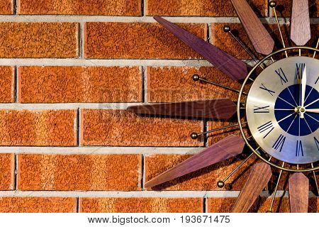 Vintage clock on a brickwall right side cut off
