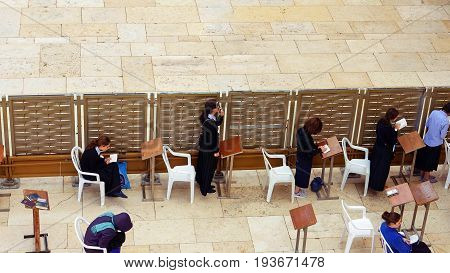 Jerusalem, Israel - May 21, 2017: Western Wall or Wailing Wall or Kotel in Jerusalem. Women come to pray to the Jerusalem western wall. The Wall is the most sacred place for all jews in the world.