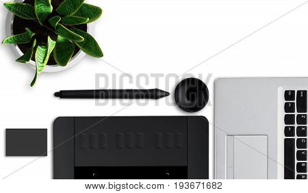 Designer desk with laptop stylus tablet for retouching and pot with green flower laying on white flat surface. Elements for retouching. Creative retoucher workspace. Design and creativity concept poster