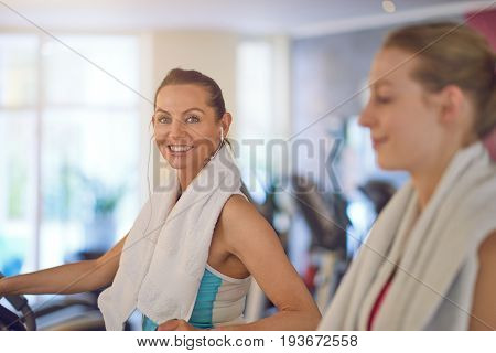 Smiling Friendly Woman Working Out With A Friend