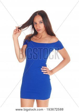 A closeup image of a East Indian young woman in a blue dress pulling her brunette hair isolated for white background.