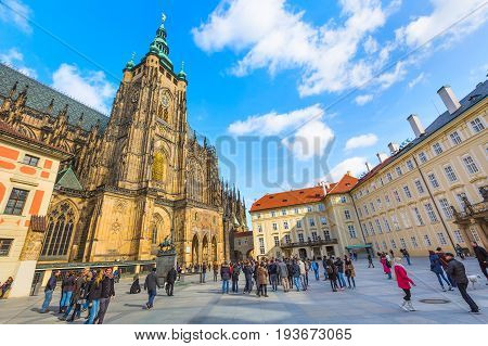 Prague, Czech Republic - February 25, 2017: Famous landmark of Prague St. Vitus Cathedral and people at the square