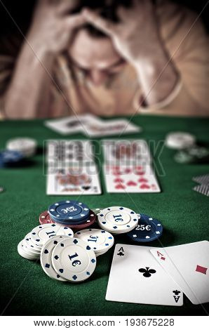 Lose player at the poker green table.