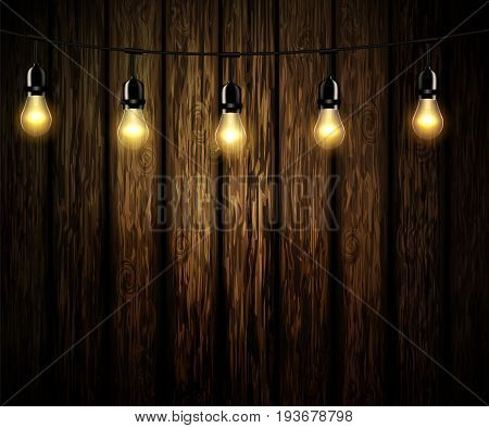 Seven light bulbs with glowing light on wooden background vector