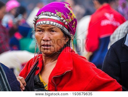 MUANG SING, LAOS - DECEMBER 28, 2012: Elderly woman in the morning market in the village of Muang Sing Laos