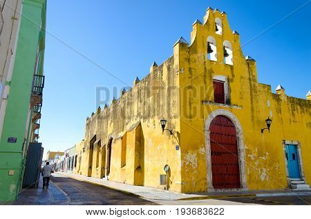 Yellow church and colonial architecture in Campeche Mexico