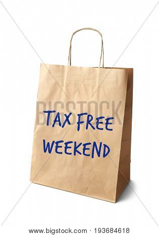 Paper bag with text TAX FREE WEEKEND on white background