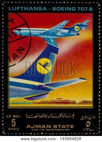 Moscow Russia - July 03 2017: A stamp printed in Ajman shows passenger airliner Boeing 707 Lufthansa series