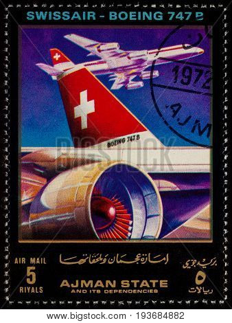 Moscow Russia - July 03 2017: A stamp printed in Ajman shows passenger airliner Boeing 747B Swissair series