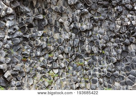 Natural Background Of Hexagonal Stone Formations In Icelandic National Park Jokulsargljufur. Black V