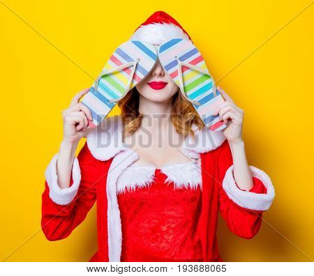 Santa Clous Girl In Red Clothes With  Flip Flops