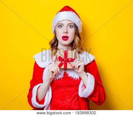 Santa Claus Girl In Red Clothes With Gift Box
