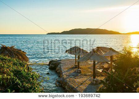 Sunrise On A Beautiful Beach With Sunshade