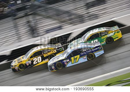 July 01, 2017 - Daytona Beach, FL, USA: Matt Kenseth (20), Ricky Stenhouse Jr. (17) and Daniel Suarez (19) battle during the Coke Zero 400 at Daytona International Speedway in Daytona Beach, FL.