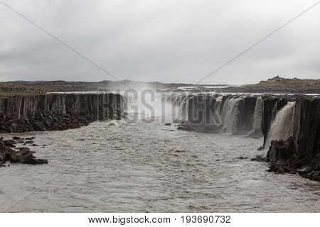 Selfoss, A Waterfall On The River Jokulsa A Fjollum In The North Of Iceland. Moody Landscape With Gr