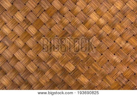 braided brown rattan Mat - stand food, close-up, macro