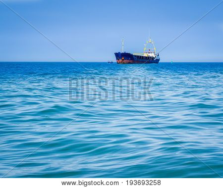 Large and small ships sail by sea water transport of various sizes under the blue sky