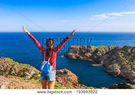 Tourist Woman With Backpack On Cap De Creus, Natural Park. Eastern Point Of Spain, Girona Province,