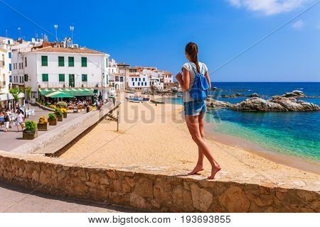 Tourist Woman In Calella De Palafrugell, Catalonia, Spain Near Of Barcelona. Scenic Fisherman Villag
