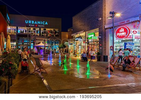ASHDOD, ISRAEL - JULY 03, 2016: Shops, boutiques and illuminated fountains in open air mall at evening - owned by BIG Shopping Centers Ltd., operates in four countries - Israel, USA, India and Serbia.