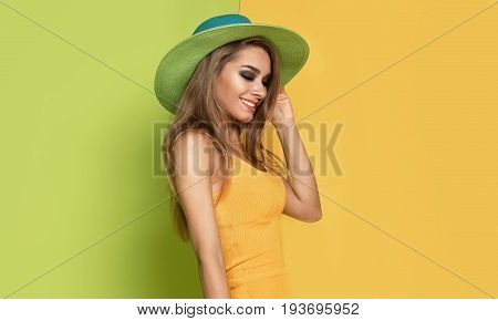 Beautiful Girl In Summer Hat Posing.