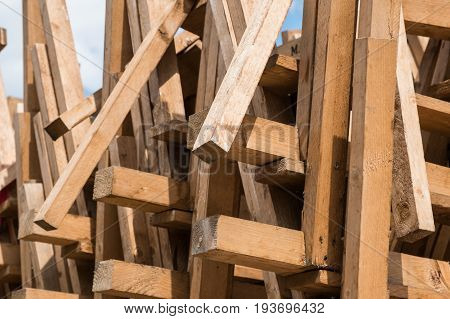 abstract wooden background - many flea market tables stacked - pile of wood market stalls