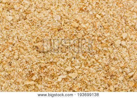 Background texture of a pile of dry bread crumbs.