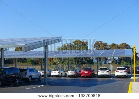 HOUSTON, USA - JANUARY 12, 2017: Some cars parked, with some solar panel protecting from the sun in Legoland park, Legoland is a theme park based on the popular LEGO brand of building toys.